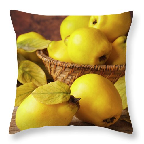 Quince Throw Pillow featuring the photograph Quinces by Syolacan