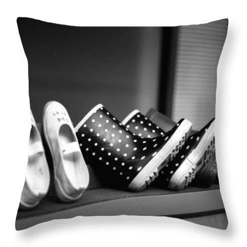 In A Row Throw Pillow featuring the photograph Rain Shoes by Snap Shooter Jp