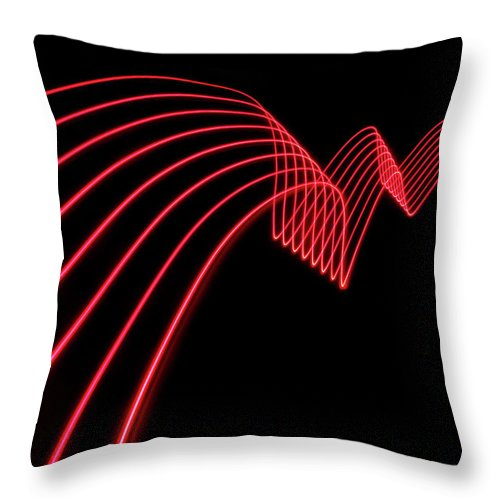 Laser Throw Pillow featuring the photograph Red Abstract Coloured Lights Trails And by John Rensten