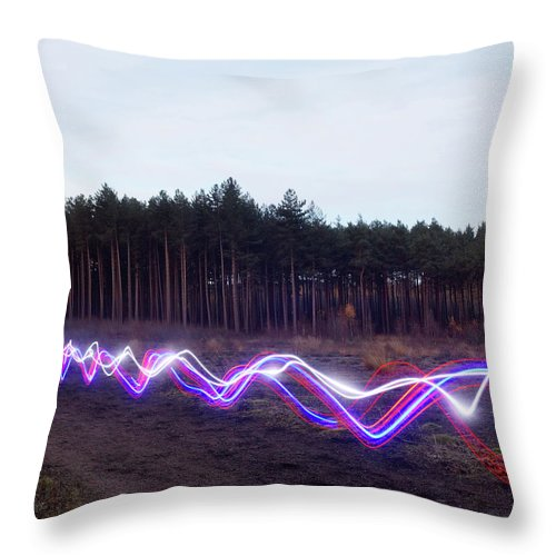 Internet Throw Pillow featuring the photograph Red, Blue And White Light Trails On by Tim Robberts
