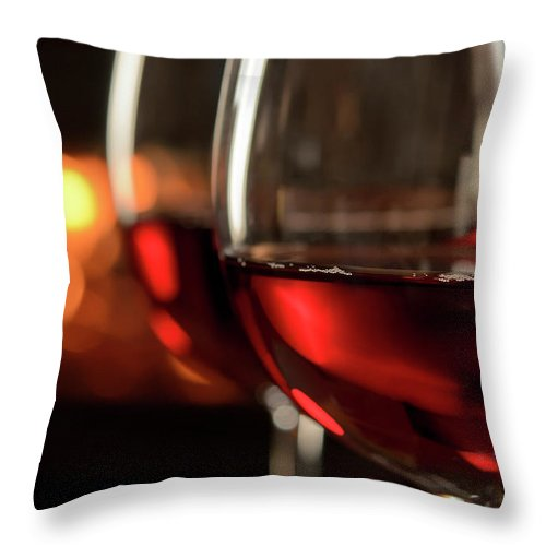 Orange Color Throw Pillow featuring the photograph Red Wine By The Fire by Nightanddayimages