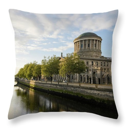 Dublin Throw Pillow featuring the photograph River Liffey And The Four Courts In by Lleerogers