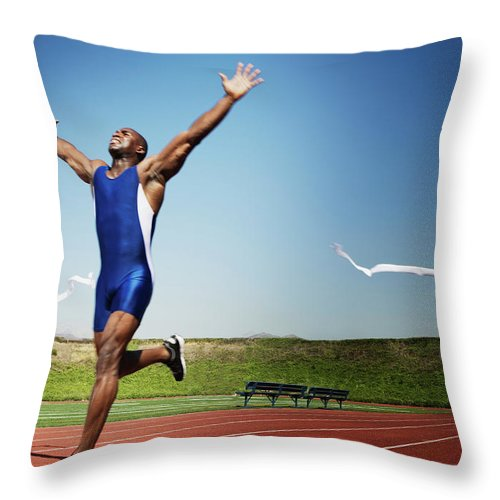 Human Arm Throw Pillow featuring the photograph Runner Crossing Finish Line by Jupiterimages