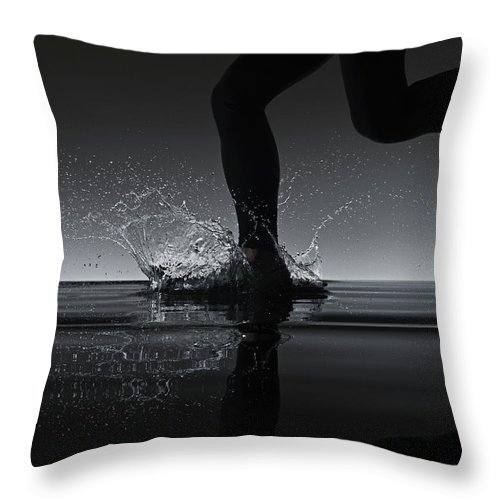 Recreational Pursuit Throw Pillow featuring the photograph Running Through Water by Jonathan Knowles