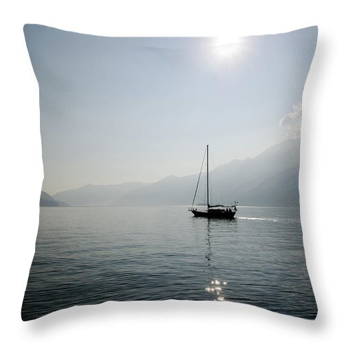 Sailboat Throw Pillow featuring the photograph Sailing Boat In Alpine Lake by Mats Silvan