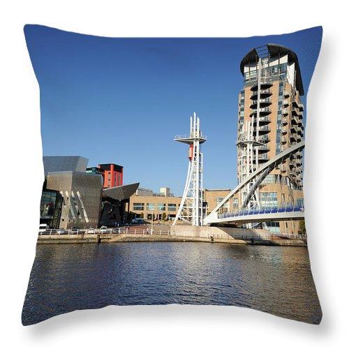 London Millennium Footbridge Throw Pillow featuring the photograph Salford Quays, Manchester by Chrishepburn
