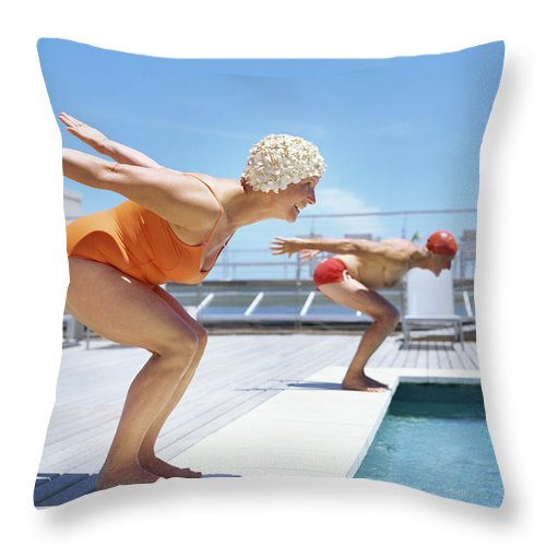 Diving Into Water Throw Pillow featuring the photograph Senior Couple Ready To Dive In To by Stockbyte
