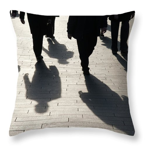 Shadow Throw Pillow featuring the photograph Shadow Team Of Commuters Walking On by Peskymonkey