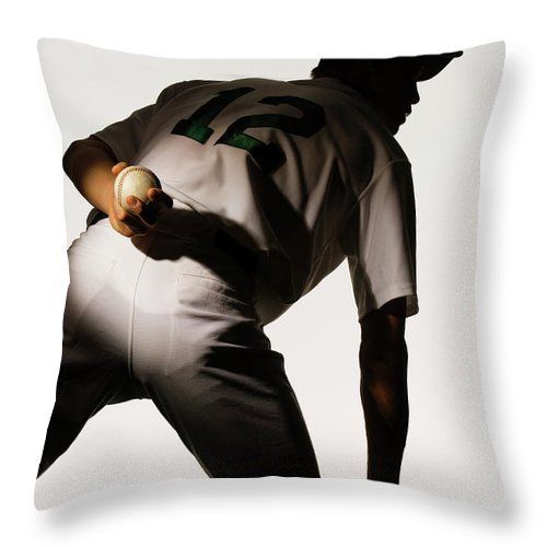 Three Quarter Length Throw Pillow featuring the photograph Silhouette Of Baseball Pitcher Holding by Pm Images