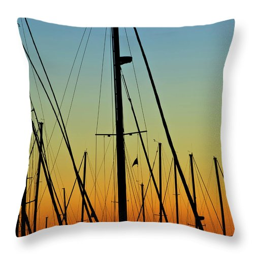 Sailboat Throw Pillow featuring the photograph Silhouettes Of Sail Boat Masts And by Joseph Shields