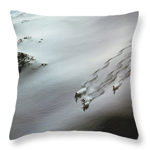 Shadow Throw Pillow featuring the photograph Skier Moving Down In Snow On Slope by John P Kelly