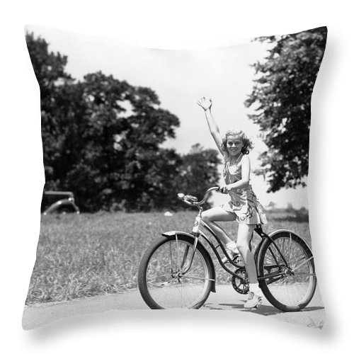 Bicycle Seat Throw Pillow featuring the photograph Smiling Girl Wearing A Jumper Short Set by H. Armstrong Roberts