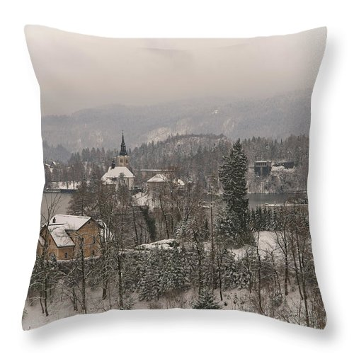 Christmas Throw Pillow featuring the photograph Snowy Bled In Slovenia by MSVRVisual Rawshutterbug