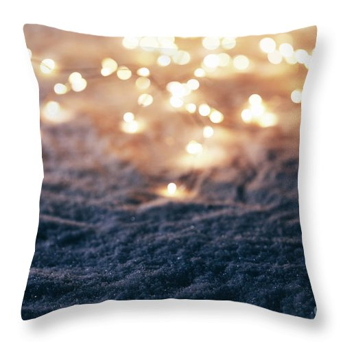 Winter Throw Pillow featuring the photograph Snowy Winter Background With Fairy Lights. by Michal Bednarek