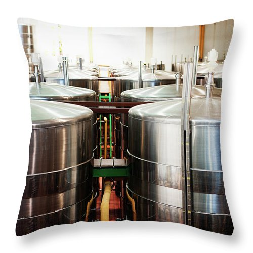 Working Throw Pillow featuring the photograph Stainless Steel Holding Tanks In A by Rapideye