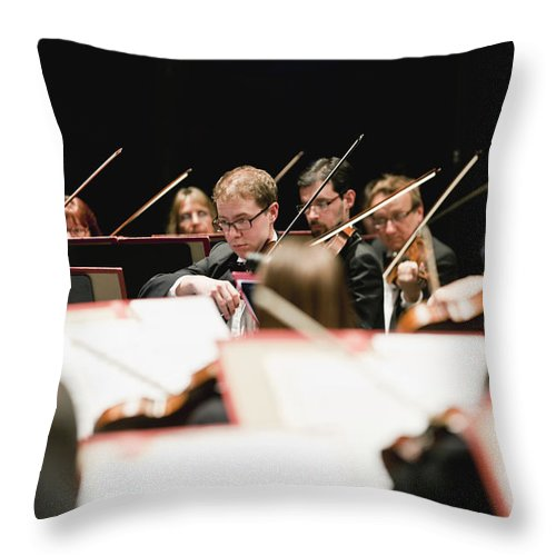 Young Men Throw Pillow featuring the photograph String Section In Orchestra by Hybrid Images