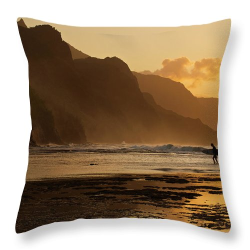 Tranquility Throw Pillow featuring the photograph Surfer On Beach And Na Pali Coast Seen by Enrique R. Aguirre Aves
