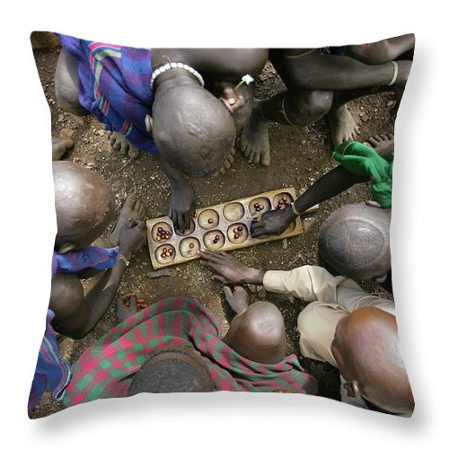 Nut Throw Pillow featuring the photograph Suri Tribal Game Of Mancala Seen From by Timothy Allen