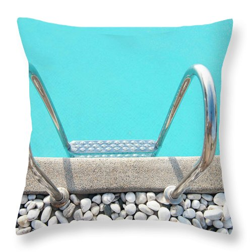 Tranquility Throw Pillow featuring the photograph Swimming Pool With White Pebbles by Lawren