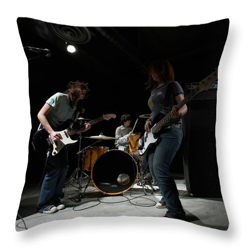 Cool Attitude Throw Pillow featuring the photograph Teenage 14-16 Band Playing Instruments by Thomas Northcut