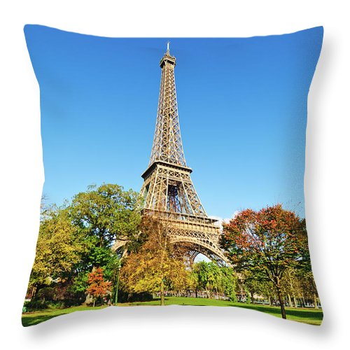 Clear Sky Throw Pillow featuring the photograph The Eiffel Tower With Some Autumnal by Tom Bonaventure