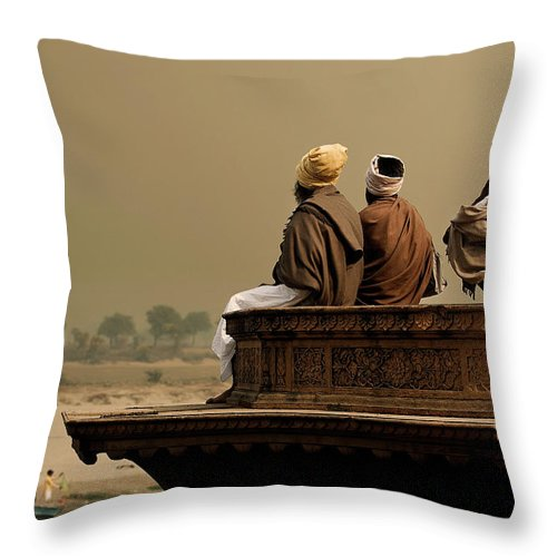 Water's Edge Throw Pillow featuring the photograph Three Sadhus Meditating By The Yamuna by Globalstock