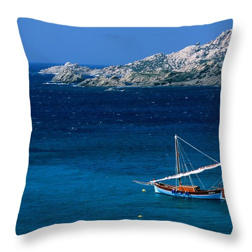 Sailboat Throw Pillow featuring the photograph Traditional Sailboat On Rocky Coast Of by Dallas Stribley