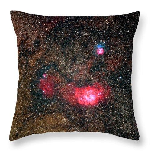 Sky Throw Pillow featuring the photograph Trifid Nebulae And Lagoon Nebula by Imagenavi