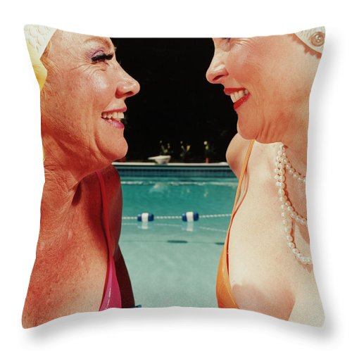 Mature Adult Throw Pillow featuring the photograph Two Women By Pool by Silvia Otte