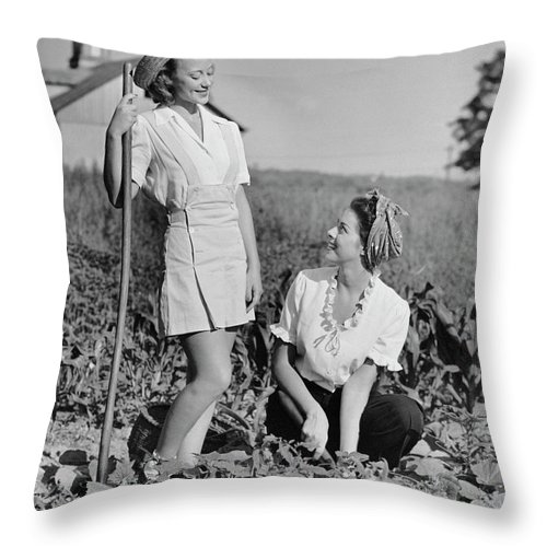 People Throw Pillow featuring the photograph Two Women Gardening In Field by George Marks