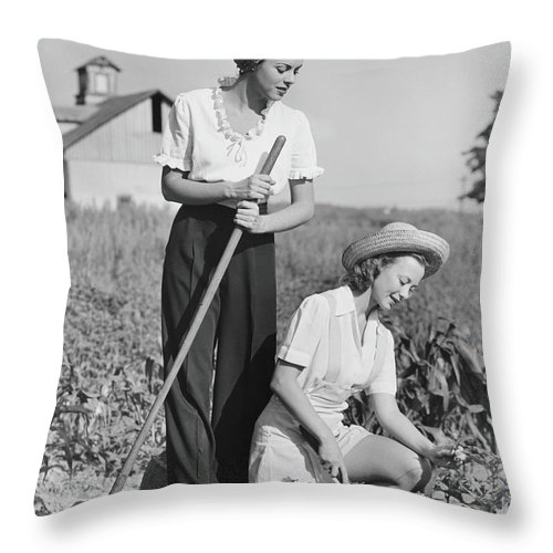 Straw Hat Throw Pillow featuring the photograph Two Women Working On Field, B&w by George Marks