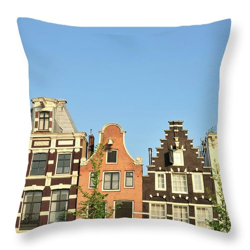 In A Row Throw Pillow featuring the photograph Typical Canal Houses, Amsterdam, The by Gorazdbertalanic
