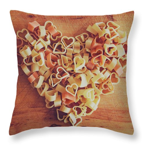 Italian Food Throw Pillow featuring the photograph Uncooked Heart-shaped Pasta by Julia Davila-lampe