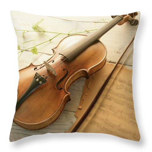 Sheet Music Throw Pillow featuring the photograph Violin And Music Sheet by Image Work/amanaimagesrf