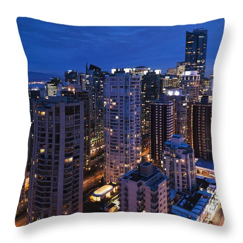 Outdoors Throw Pillow featuring the photograph West End Buildings Along Robson Street by Walter Bibikow