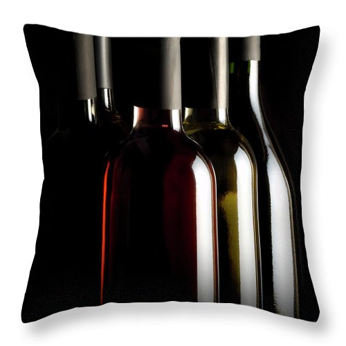 Rose Wine Throw Pillow featuring the photograph Wine Bottles by Carlosalvarez