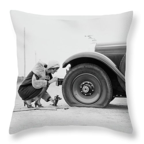 People Throw Pillow featuring the photograph Woman Changing Flat Tire On Car by H. Armstrong Roberts