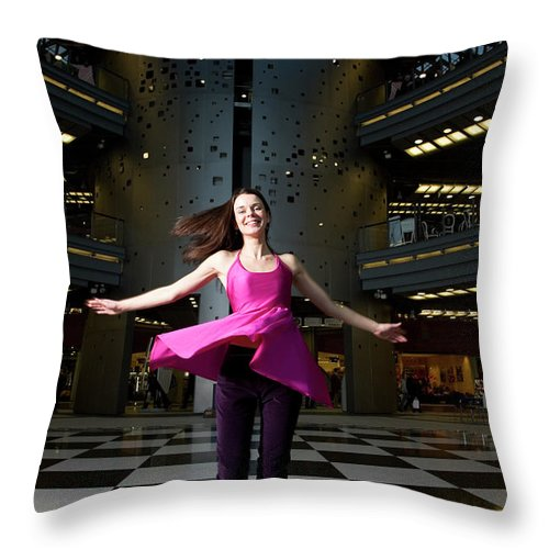 People Throw Pillow featuring the photograph Woman Dancing In Old Brewery Shopping by Tim E White