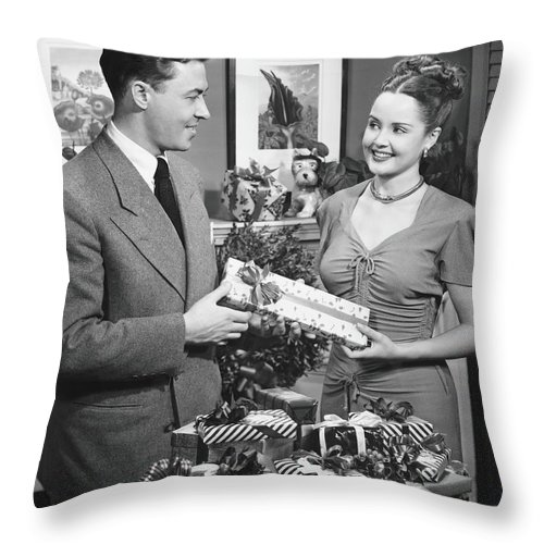 Heterosexual Couple Throw Pillow featuring the photograph Woman Giving Gift To Man, B&w by George Marks