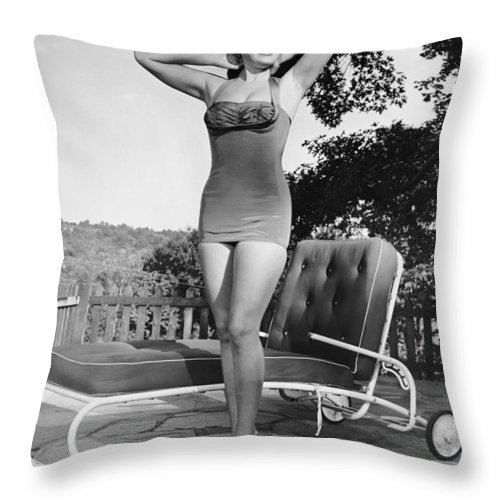 People Throw Pillow featuring the photograph Woman In Bathing Suit Outdoors by George Marks