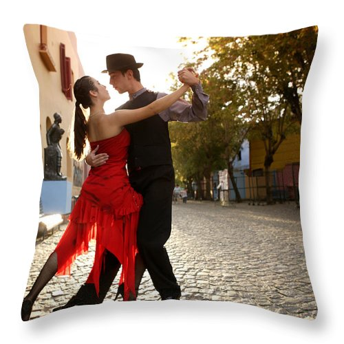 Young Men Throw Pillow featuring the photograph Young Couple Dancing Tango In Street by Buena Vista Images