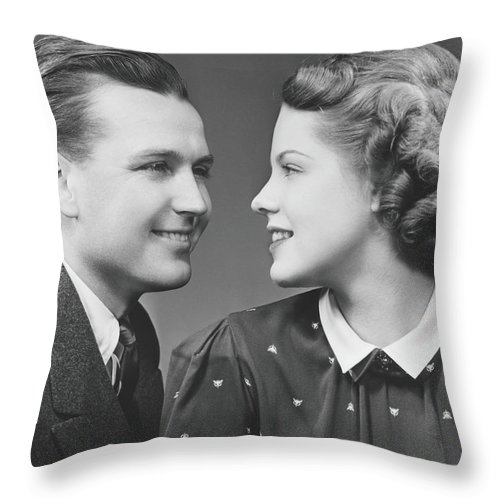 Young Men Throw Pillow featuring the photograph Young Couple Looking In Eyes In Studio by George Marks
