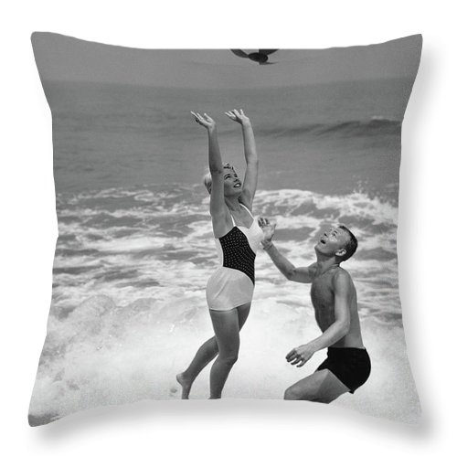 Young Men Throw Pillow featuring the photograph Young Couple Playing With Beach Ball At by Stockbyte