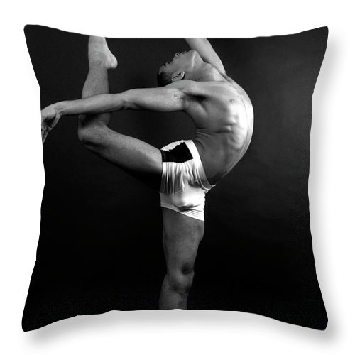 Human Arm Throw Pillow featuring the photograph Young Male In Dancer Pose by Michael Rowe