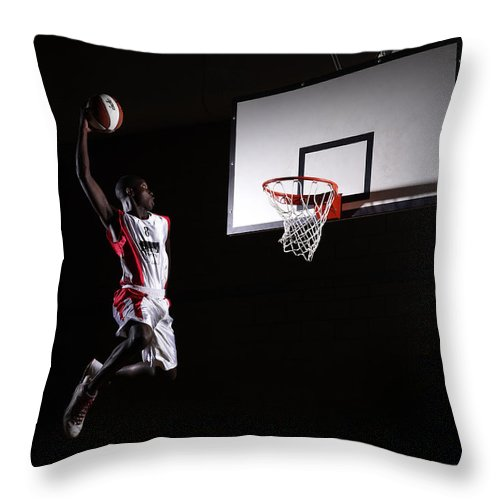 Human Arm Throw Pillow featuring the photograph Young Man In The Air About To Dunk The by Compassionate Eye Foundation/steve Coleman/ojo Images Ltd