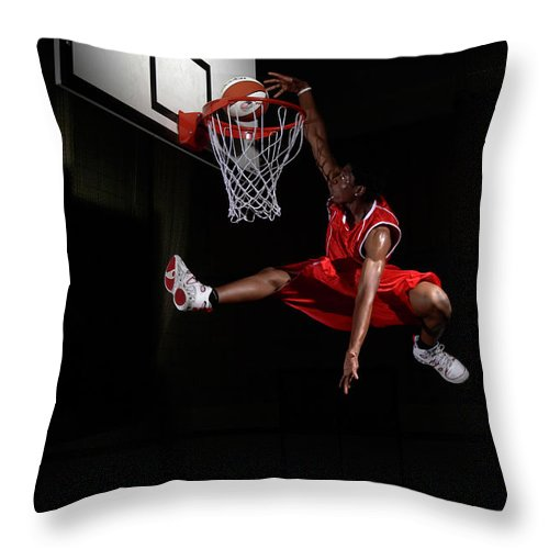 Human Arm Throw Pillow featuring the photograph Young Man Making A Fancy Dunk by Compassionate Eye Foundation/steve Coleman/ojo Images Ltd