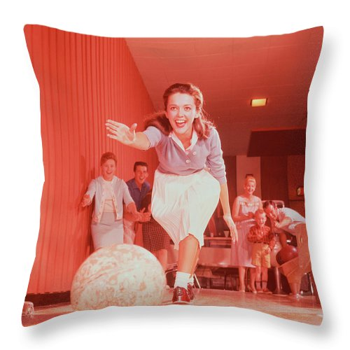 People Throw Pillow featuring the photograph Young Woman Bowling, Family Watching In by Fpg