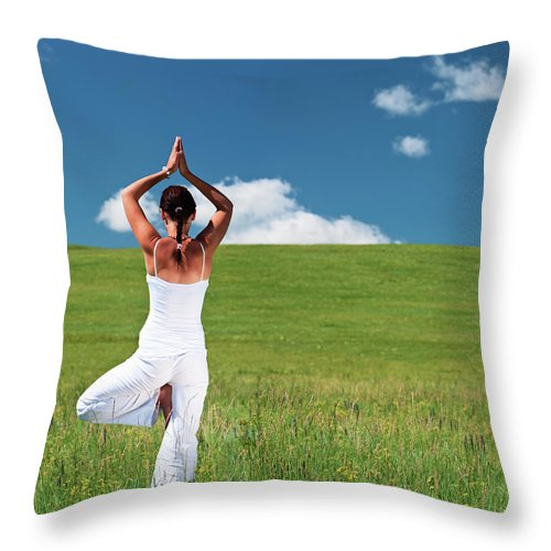 Scenics Throw Pillow featuring the photograph Young Woman Practicing Yoga by Hadynyah