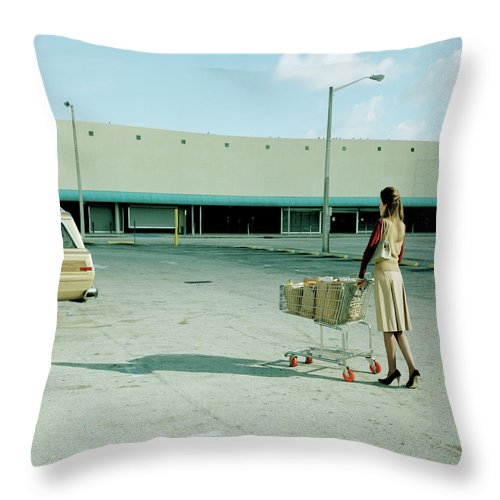 Casual Clothing Throw Pillow featuring the photograph Young Woman Pushing Trolly Full Of by Kelvin Murray