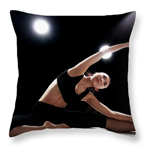 People Throw Pillow featuring the photograph Young Woman Stretching by Runphoto